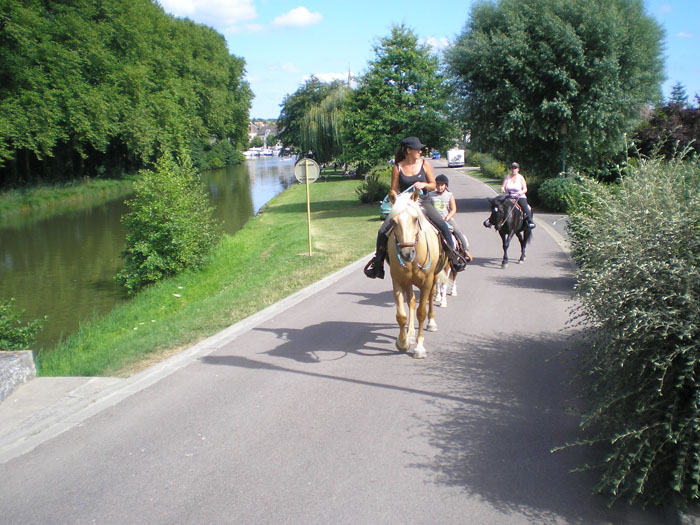 family horse riding on a motorhome trip