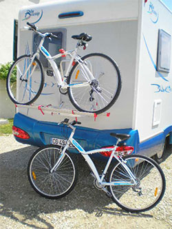 Two bikes onthe back of a motorhome