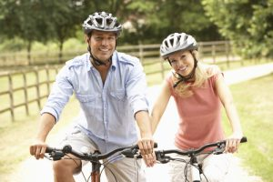 Couple Cycling In French Countryside