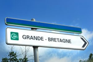 Road sign pointing the way towards the Channel Tunnel and Grand Bretagne or Great Britain.