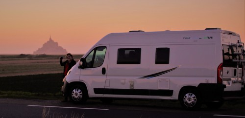 A campervan parked up with Mont St Michel in distance