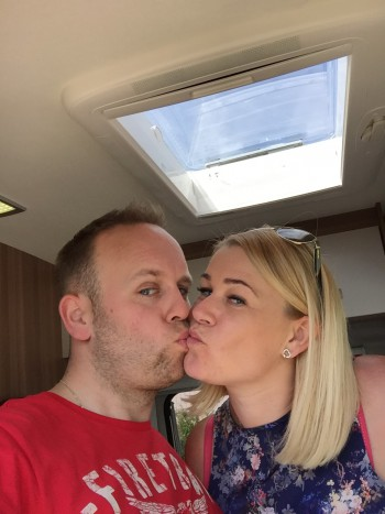 Couple kissing in their motorhome