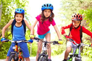 Three children riding their bikes in France