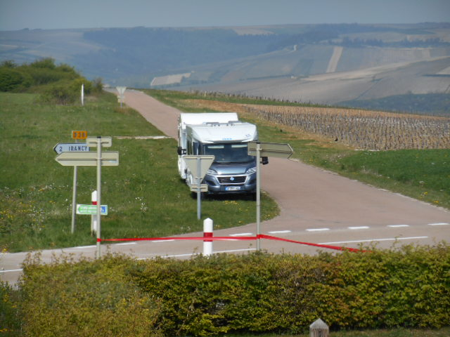 View of two motorhomes parked next to a vineyard in Burgundy, France