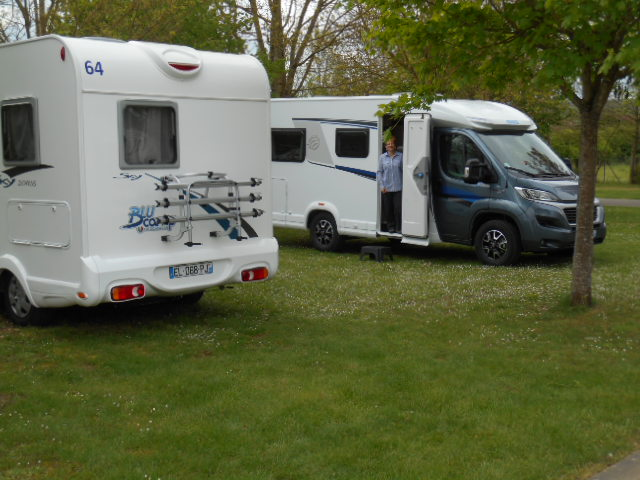 Two motorhomes parked in a campsite in France