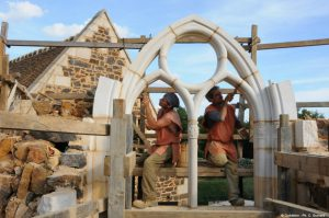 Volunteers working on the medieval Guédelon castle windows
