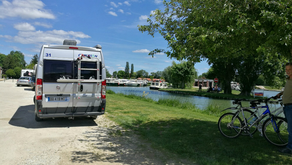 Rear view of a campervan parked alongside the Burgundy Canal