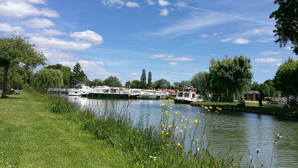 View of the embankment of the Burgundy Canal looking towards Saint Florentin while wild camping in france for motorhomes
