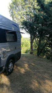 Shaded motorhome pitch at Domaine d'Arnauteille campsite