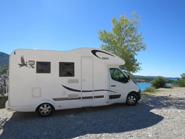 motorhome parked at a lakeside in France