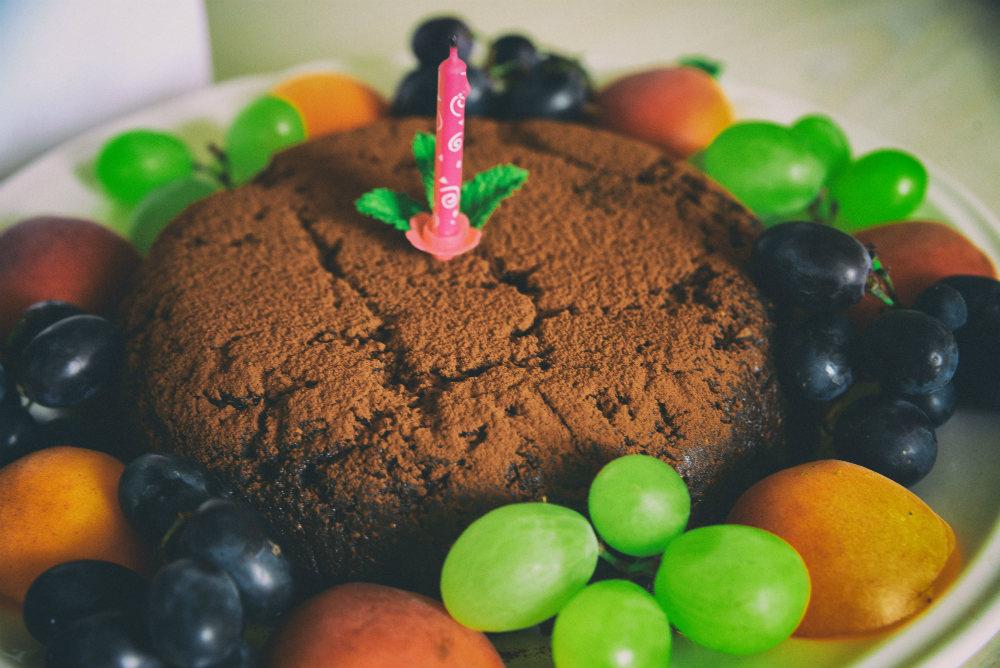 No-bake chocolate cake surruonded by fresh fruit