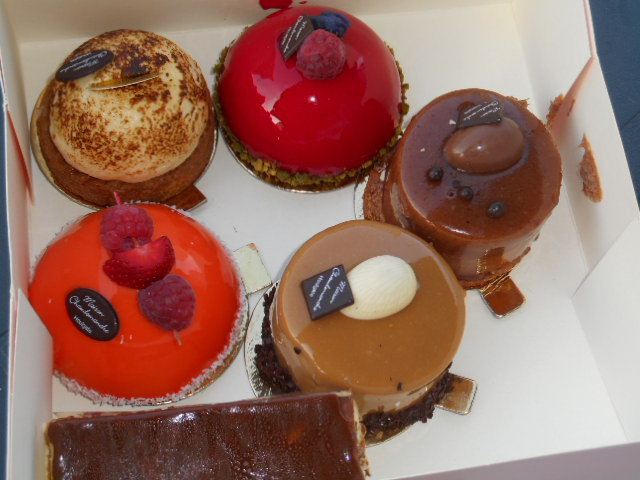 Selectio of small cakes from a patisserie in France