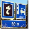 Take a ticket sign on a French autoroute