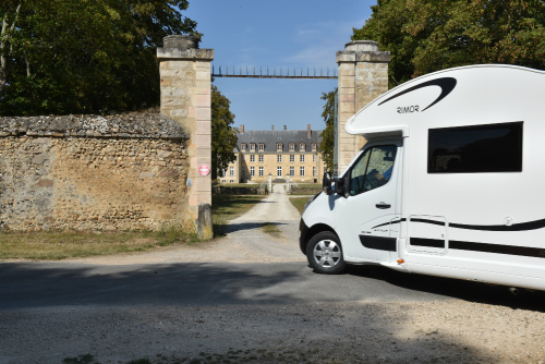 Motorhome parked in front of a French chateau getting in place to watch the Ryder Cup
