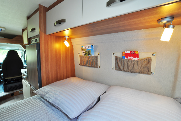 Sleeping area inside a cosy campervan, warm enough for chilly October nights