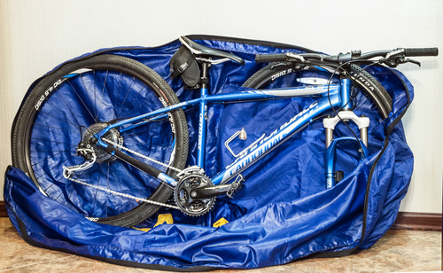 Road bike in a soft travel boke bag