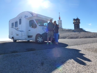 A couple infront of a motorhome on Mont Ventoux