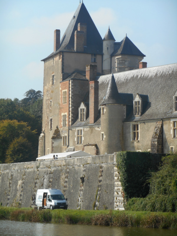 A campervan parked beside a Loire Valley chateau