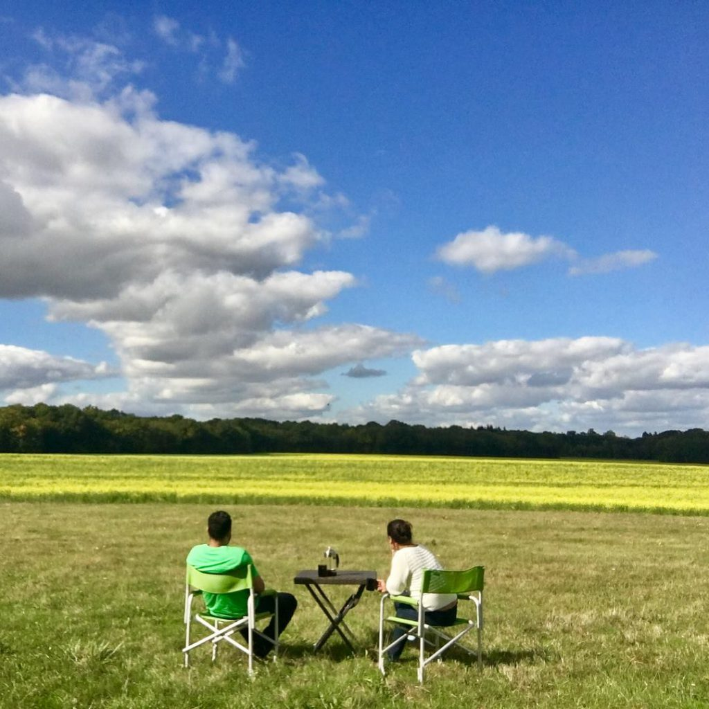 Two people sitting on camping chairs in the Loire Valley