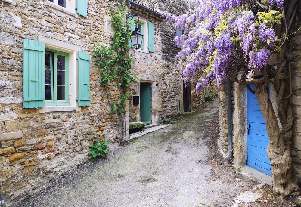 You will see wisteria clad, historic buildings from your motorhome on a May campervan trip