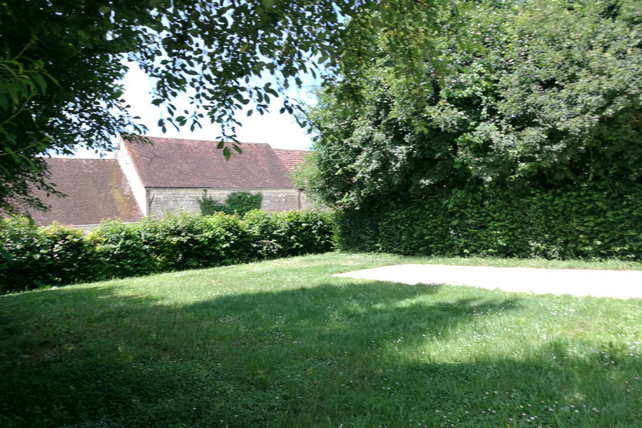 Large shady pitches at La Ferme des Hauts Frenes Campsite in The Foret d'Othe